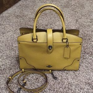 Coach leather mustard color handbag.